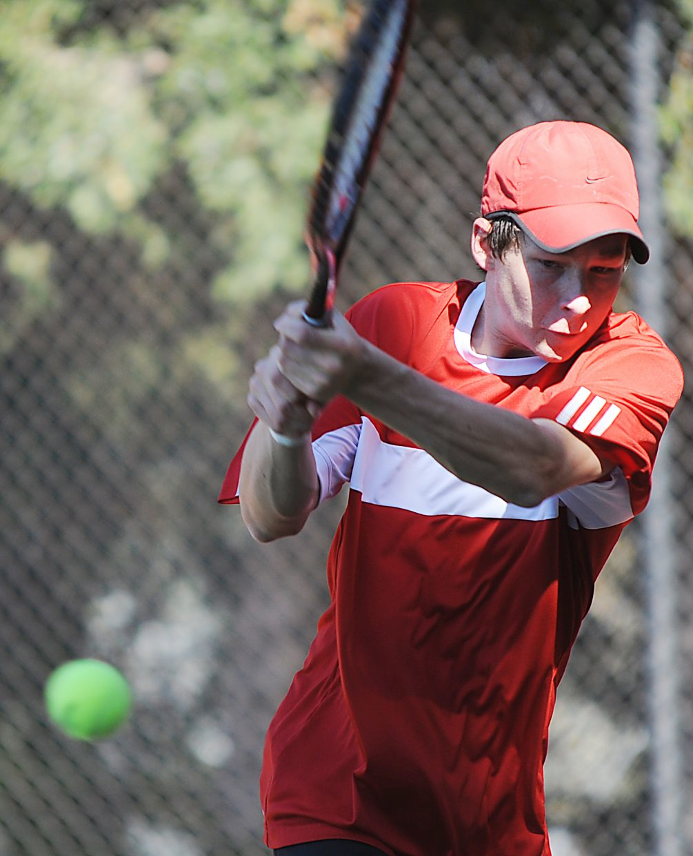Jamey Swiggart eyes the ball Thursday at the state tennis tournament in Pueblo.