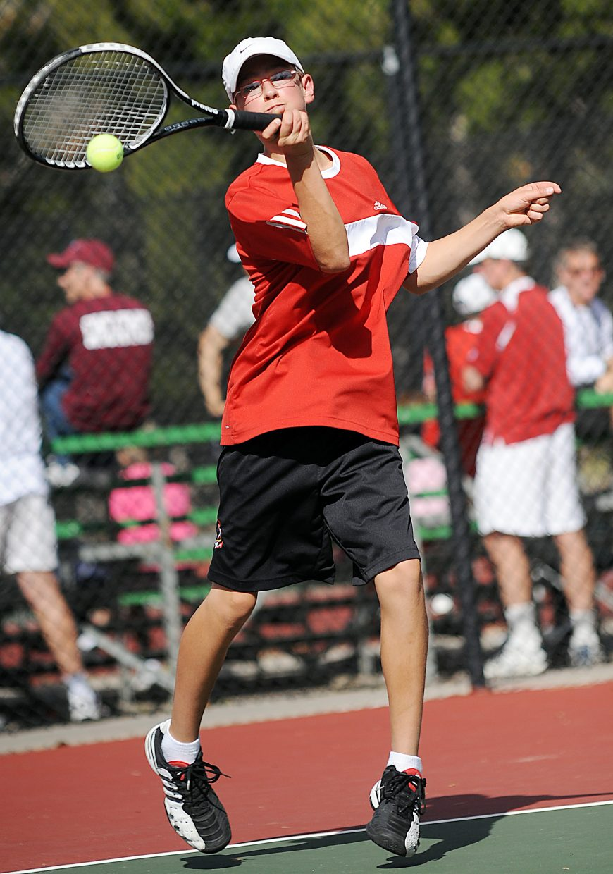 Kyle Rogers swings for the ball Thursday at the state tennis tournament in Pueblo.