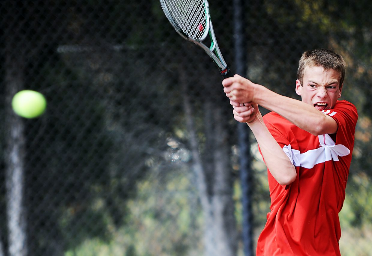 Keegan Burger knocks the ball Thursday at the state tennis tournament in Pueblo.
