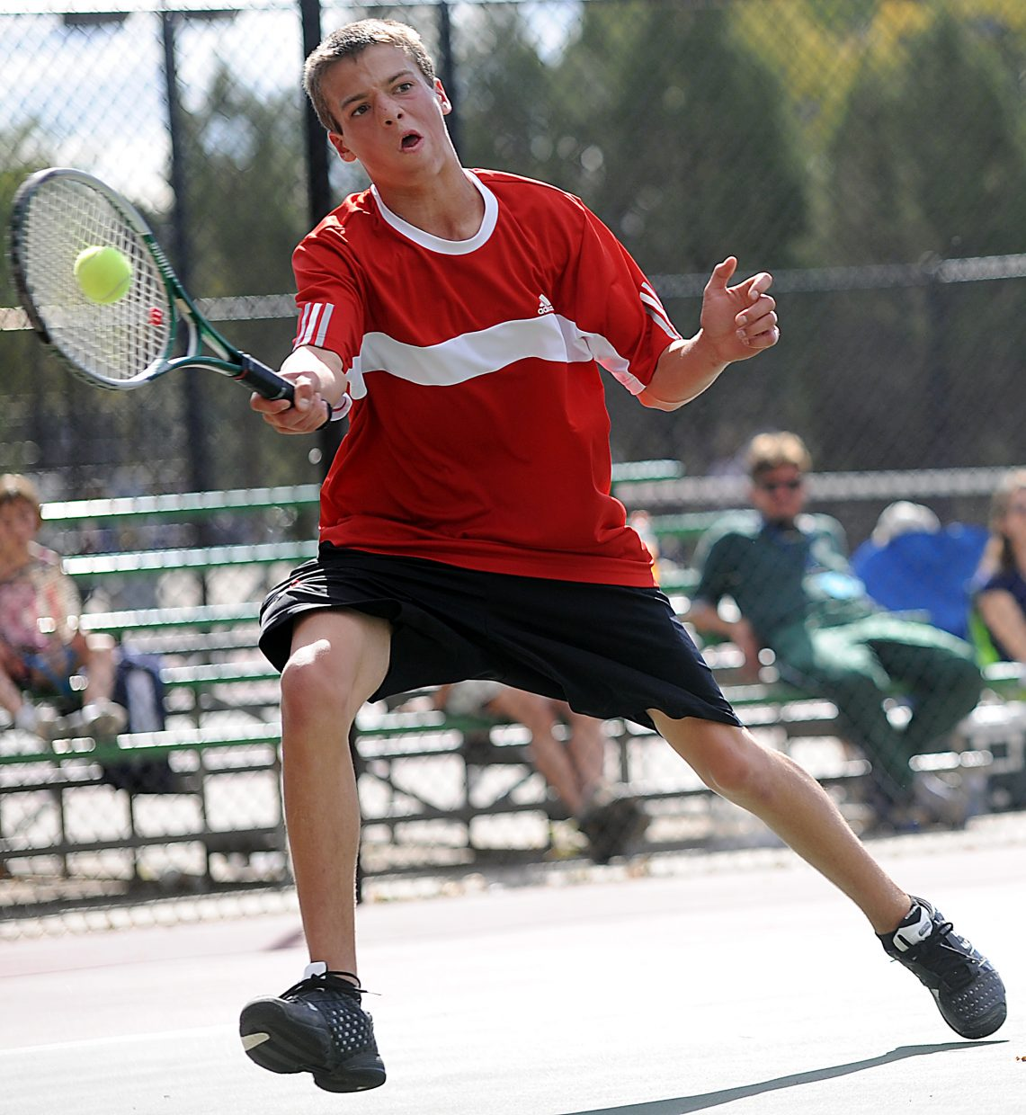 Keegan Burger swings Thursday at the state tennis tournament in Pueblo.