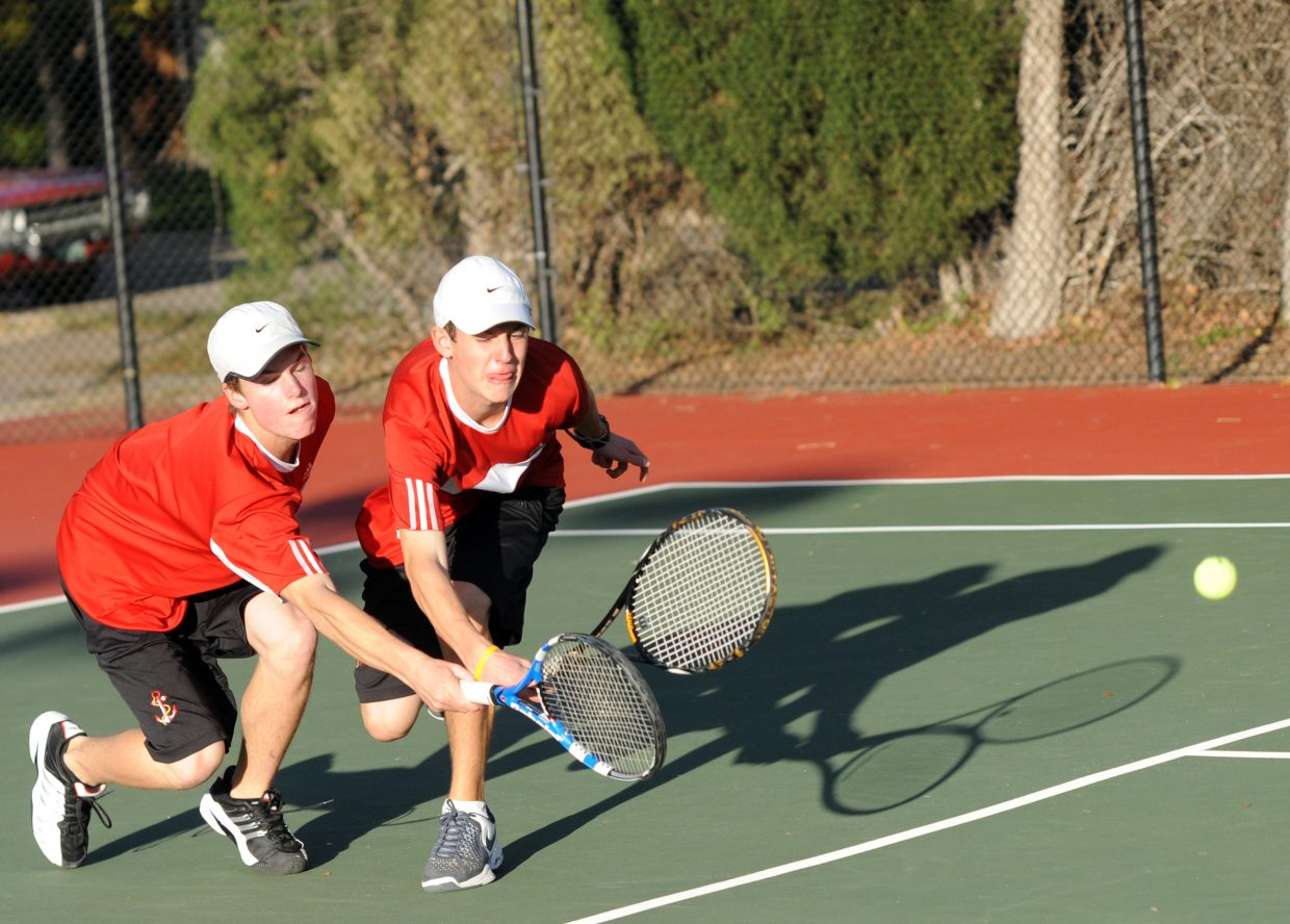 Luke Farny, left, and Callum Richman brace for impact as they collide while chasing a ball during the third set of their No. 3 doubles quarterfinal match at the state tennis tournament in Pueblo. Like most of the other Sailors, the pair fought hard to force three sets but couldn't pull out the victory. Only the No. 4 doubles team of Gabri Erspamer and Kyle Rogers won both matches Thursday to advance to today's semifinals.