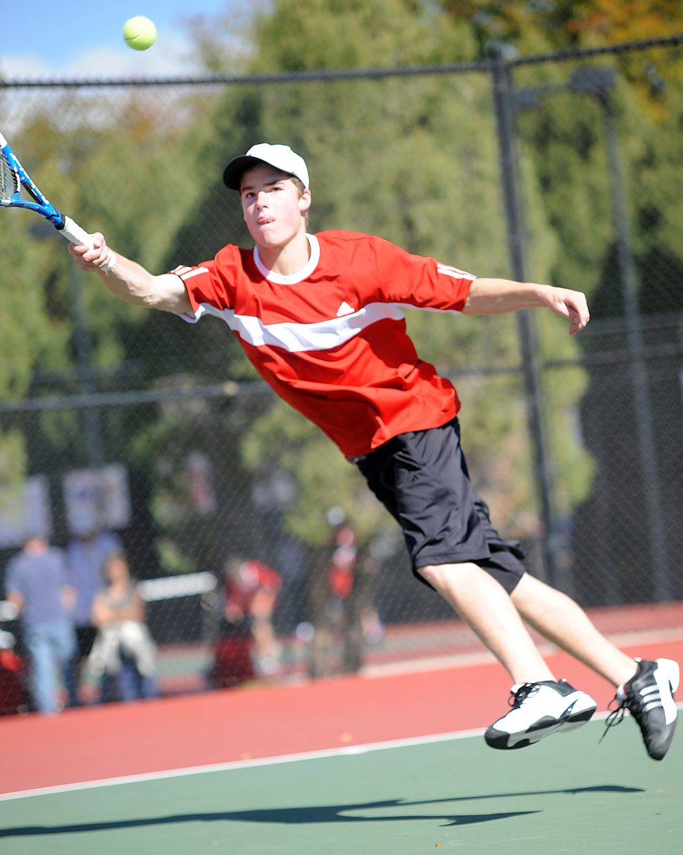 Luke Farny leaps for a ball Thursday as the state tennis tournament in Pueblo.