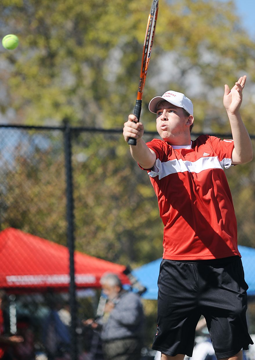 Vladan Chase taps a return Thursday during the state tennis tournament in Pueblo.