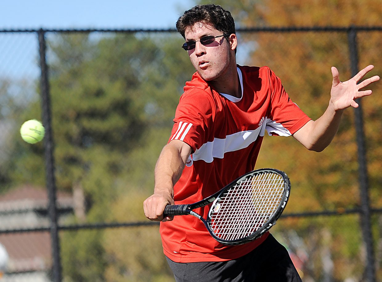 Mirko Erspamer reaches for a return Thursday at the state tennis tournament in Pueblo.