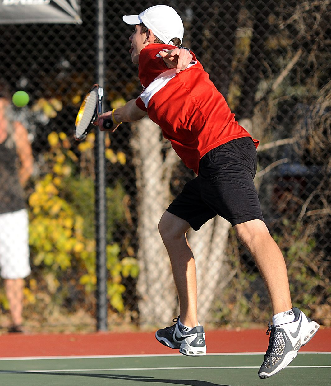 Callum Richman tries to catch a ball Thursday at the state tennis tournament in Pueblo.