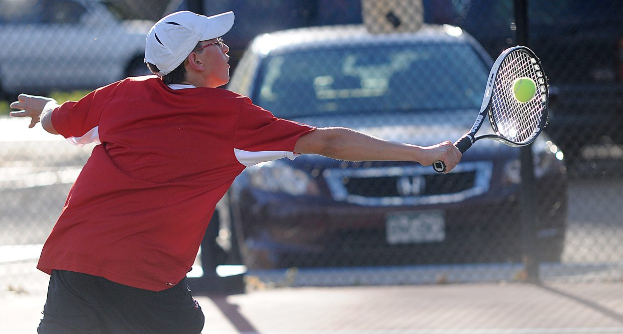 Kyle Rogers smashes a return Thursday at the state tennis tournament in Pueblo. Rogers and playing partner Gabri Erspamer will play today in the No. 4 doubles semifinals.