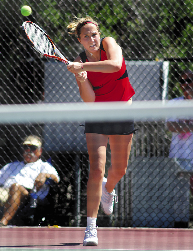 Steamboat Springs singles player Lisa Floyd returns a volley during Friday's 4A Girls State High School Tennis Championships. Floyd lost in the semifinals but rebounded to earn a spot in today's match for third place.