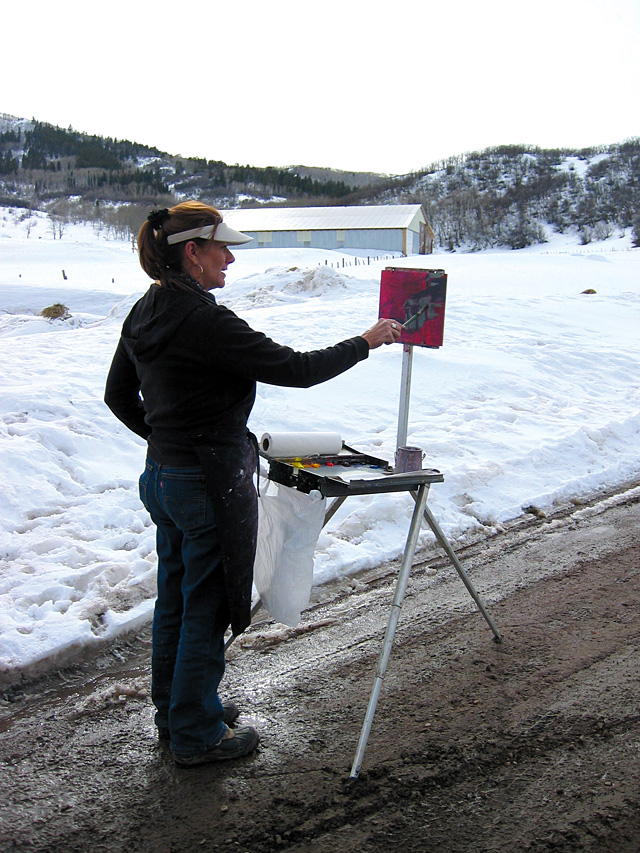 Susie Jackson paints the house next to her studio near Catamount Lake. She is one of the artists who are featured in the Steamboat Springs Arts Council's Artist Studio Tour on Saturday.
