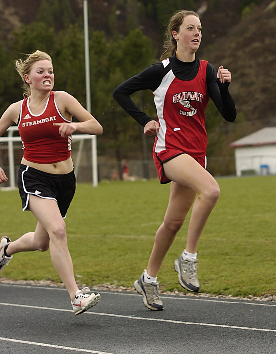 Steamboat High School's Jorid Halsnes tries to charge past a Grand Valley runner as she heads down the final stretch of the 800-meter run Saturday at the Demon Invitational track meet in Glenwood Springs.