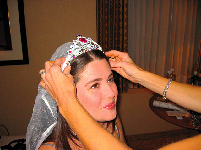 Jennifer Hollis is crowned by her sister Christie Hollis in her hotel room at the Aladdin Casino before going out to celebrate her bachlorette party in Las Vegas.