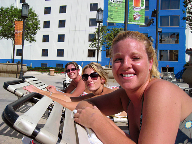 Leslie Hollis, Christie Hollis and Jodie Jensen catch some rays by the pool at the Aladdin Casino on Saturday.