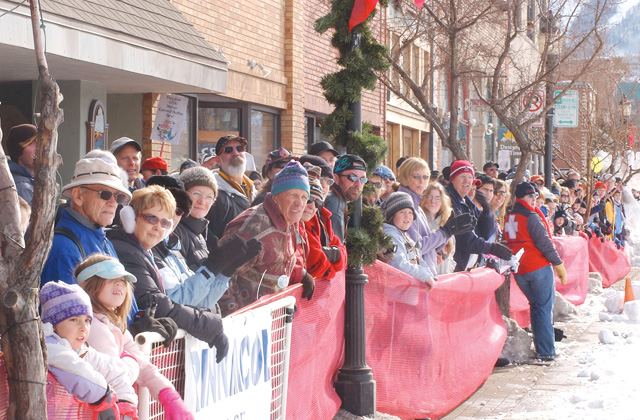 Spectators line Lincoln Avenue to watch the Winter Carnival street events.