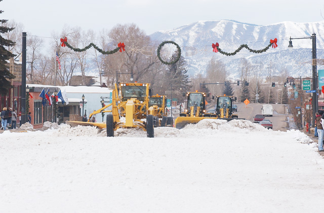 Plows begin removing the snow from Lincoln Avenue after Saturday's street events.