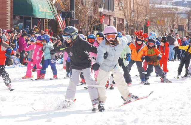 Dominique Katthain, 8, left, leads with her partner Kathleen O'Connell, 8, during the Three-Legged Race.