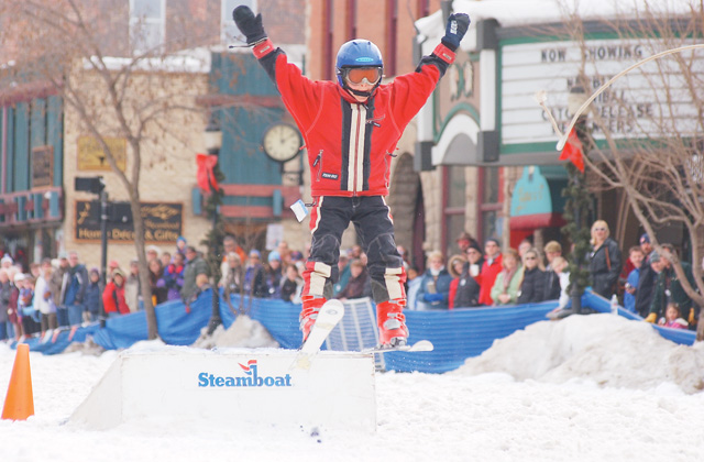 Peter Bollenbacher, 9, launches off a ramp during the Donkey Jump competition.