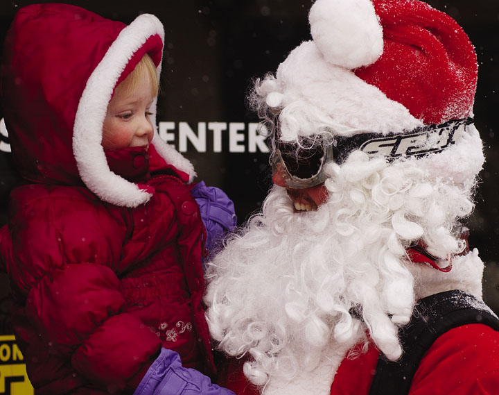 Katherine Knapp of Steamboat Springs visits with John Evans, who was skiing dressed like Santa Claus on Tuesday at the Steamboat Ski Area. Evans was accompanied by Katy Vormehr, who was dressed as Mrs. Claus.
