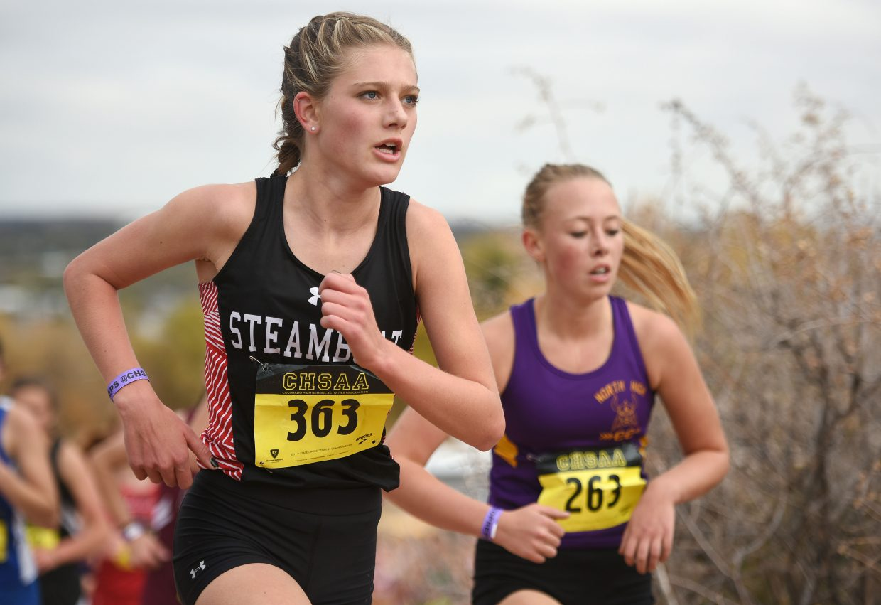 Isabelle Boniface runs up a hill in the Class 3A cross country state championship race. Boniface hopes that competitive races like the Stanford Invite will help her contend once again on the state level.