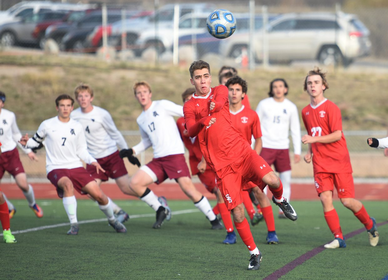 Steamboat's Murphy Bohlmann keeps his eyes on the ball Tuesday against The Classical Academy.
