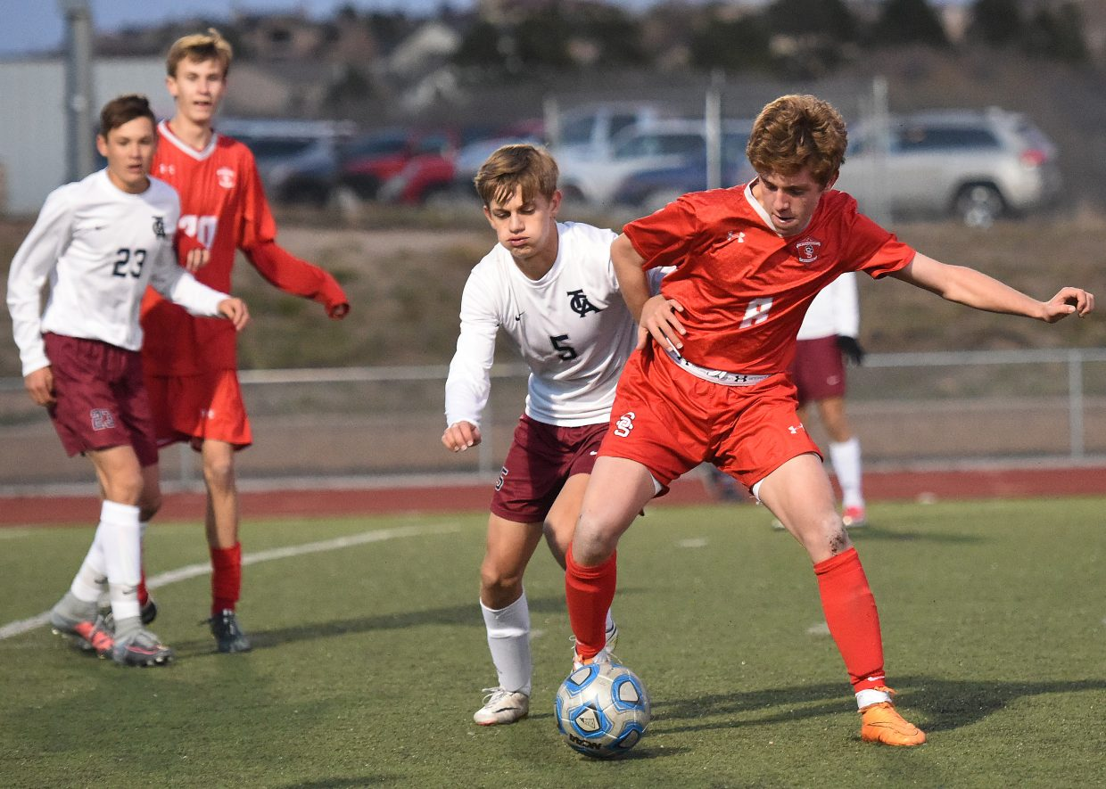 Steamboat's Cruz Erickson battles for the ball Tuesday against The Classical Academy.