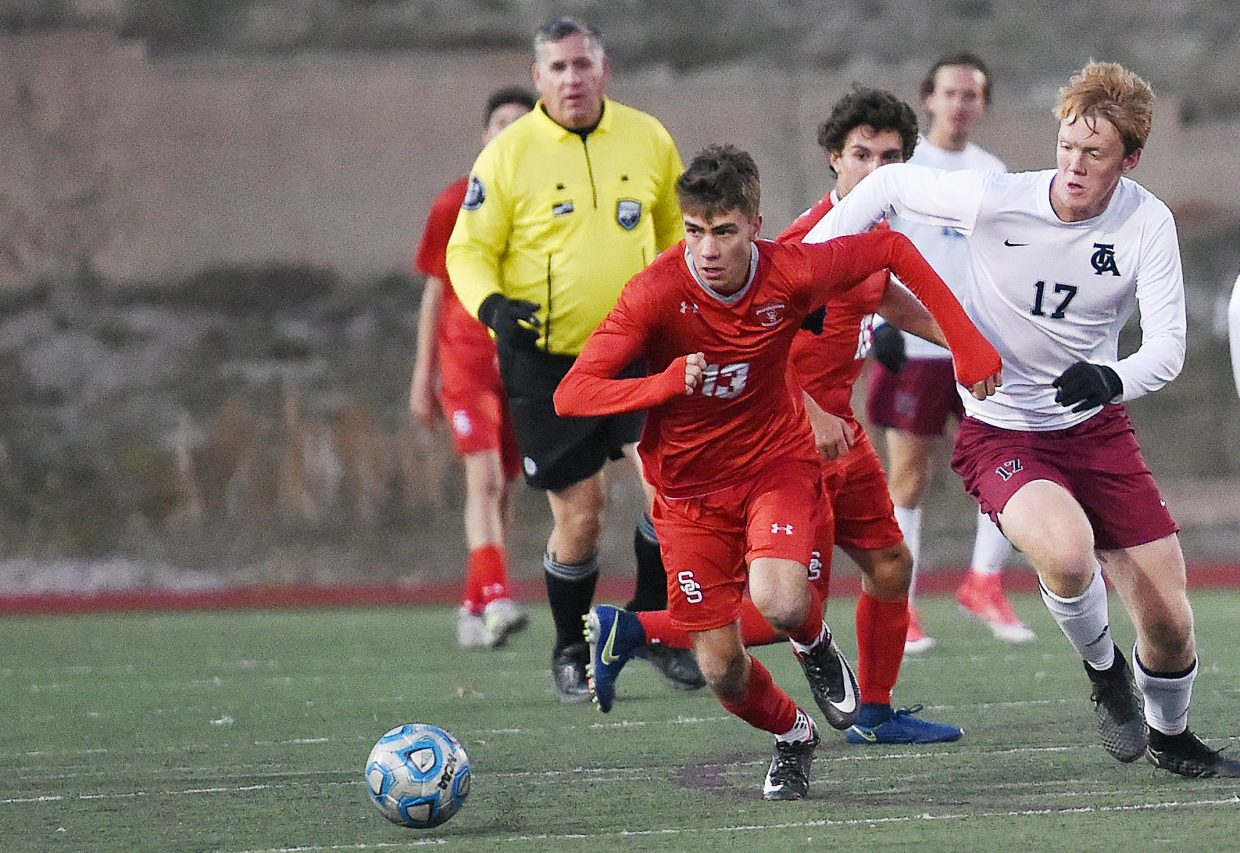 Stemaboat's Muprhy Bohlmann looks to push the ball up the field on Tuesday playing against The Classical Academy in the second round of the Class 4A state soccer tournament.