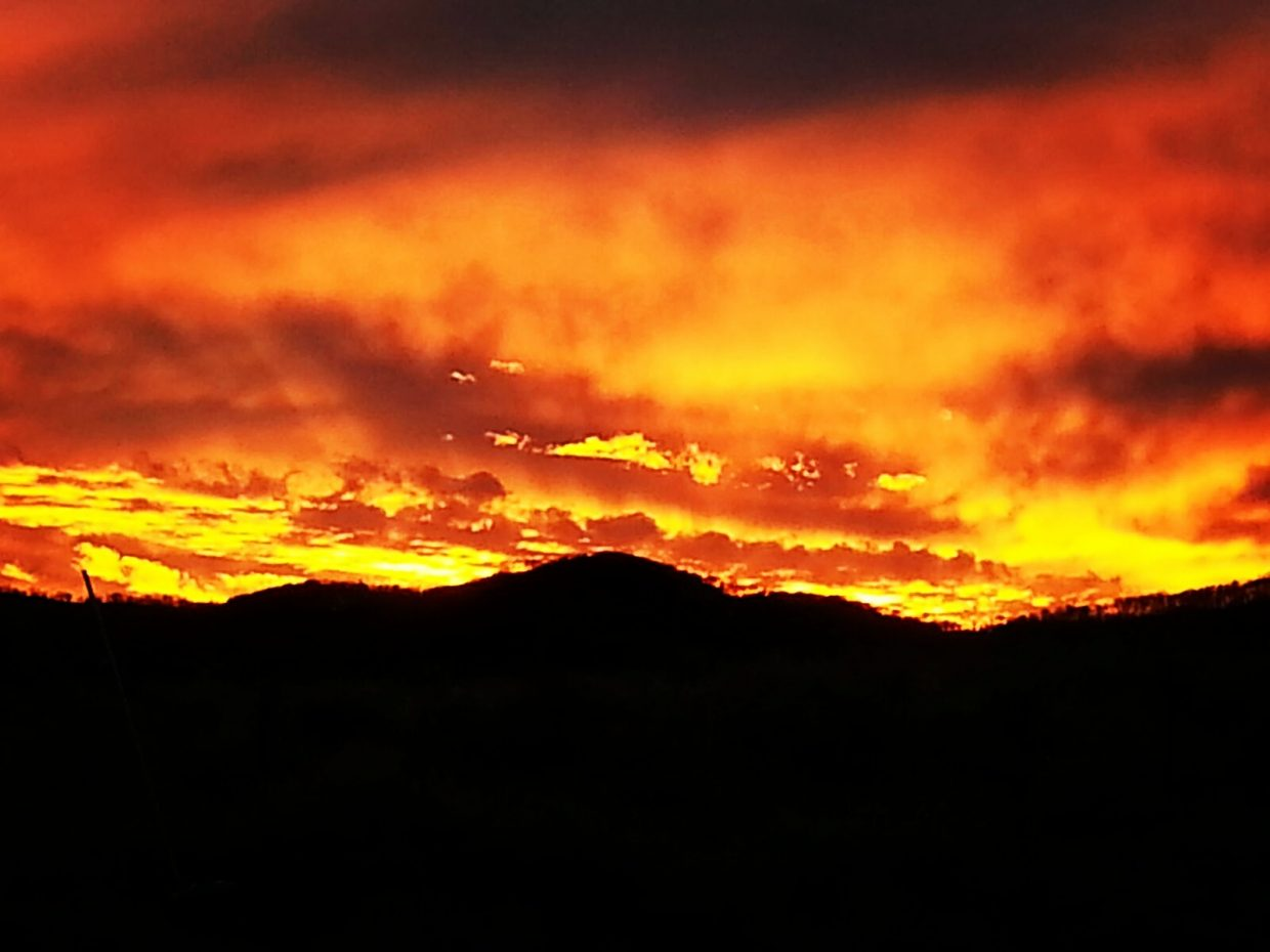 Fiery sunset over the ranch.