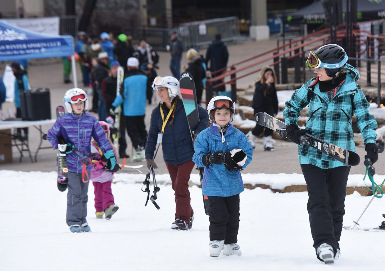 Mandolyn Wallace, and her 7-old daughter, Ashlyn, traveled from Cheyenne, Wyoming to take part in Scholarship Day, marking the first day of the ski season in Steamboat Springs Wednesday. Dedicated and excited skiers and snowboarders showed up well before the 8:30 a.m. opening of the Christie Peak Express lift to take part in the Steamboat Springs tradition.