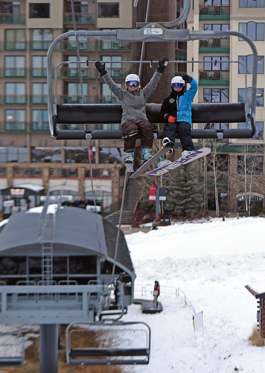 Stephanie Juno (left) and Annika Juno make their way up the Christie Peak Express lift during Scholarship Day benefitting the Steamboat Springs Winter Sports Club.
