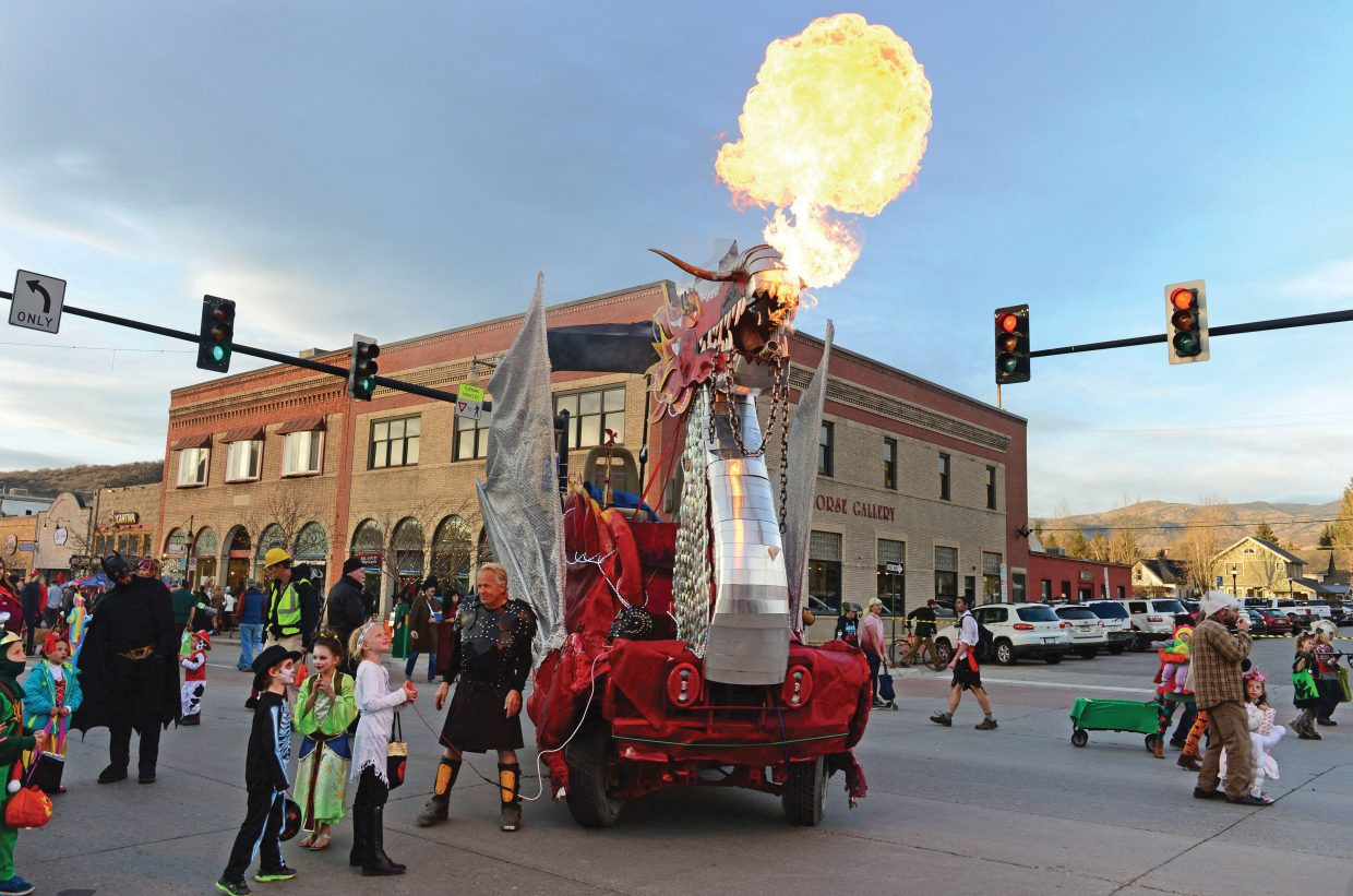 Halloween strollers got their chance to control Gail and Charlie Holthausen's fire-breathing dragon on Lincoln Avenue on Halloween night.