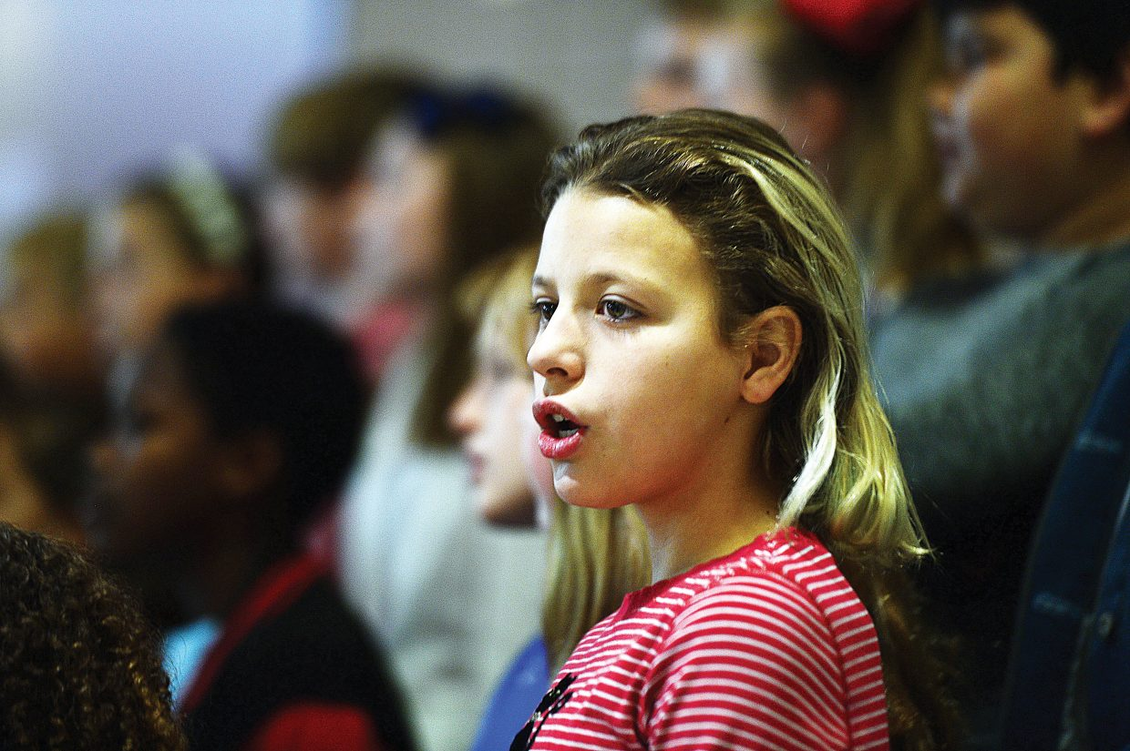 Fifth-grader Mataya Krust sings a song during Soda Creek's recognition of Veterans Day Friday morning.