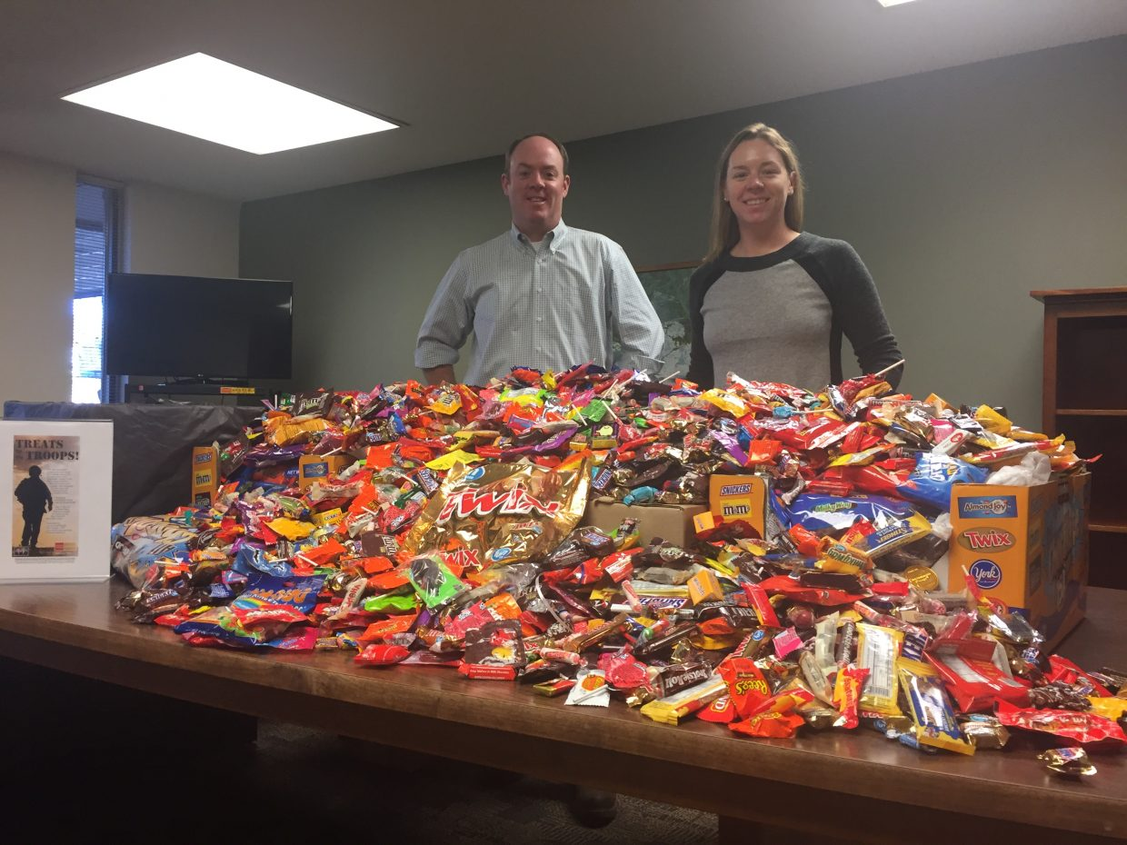 The Wells Fargo Advisors Treats for the Troops campaign set a new record for the amount of post-Halloween candy collected in Steamboat Springs. Senior financial advisors Dan Sturges and Laura Cusenbary are shown with the 320 pounds of candy that was dropped off at the bank by local residents and then shipped out to troops.