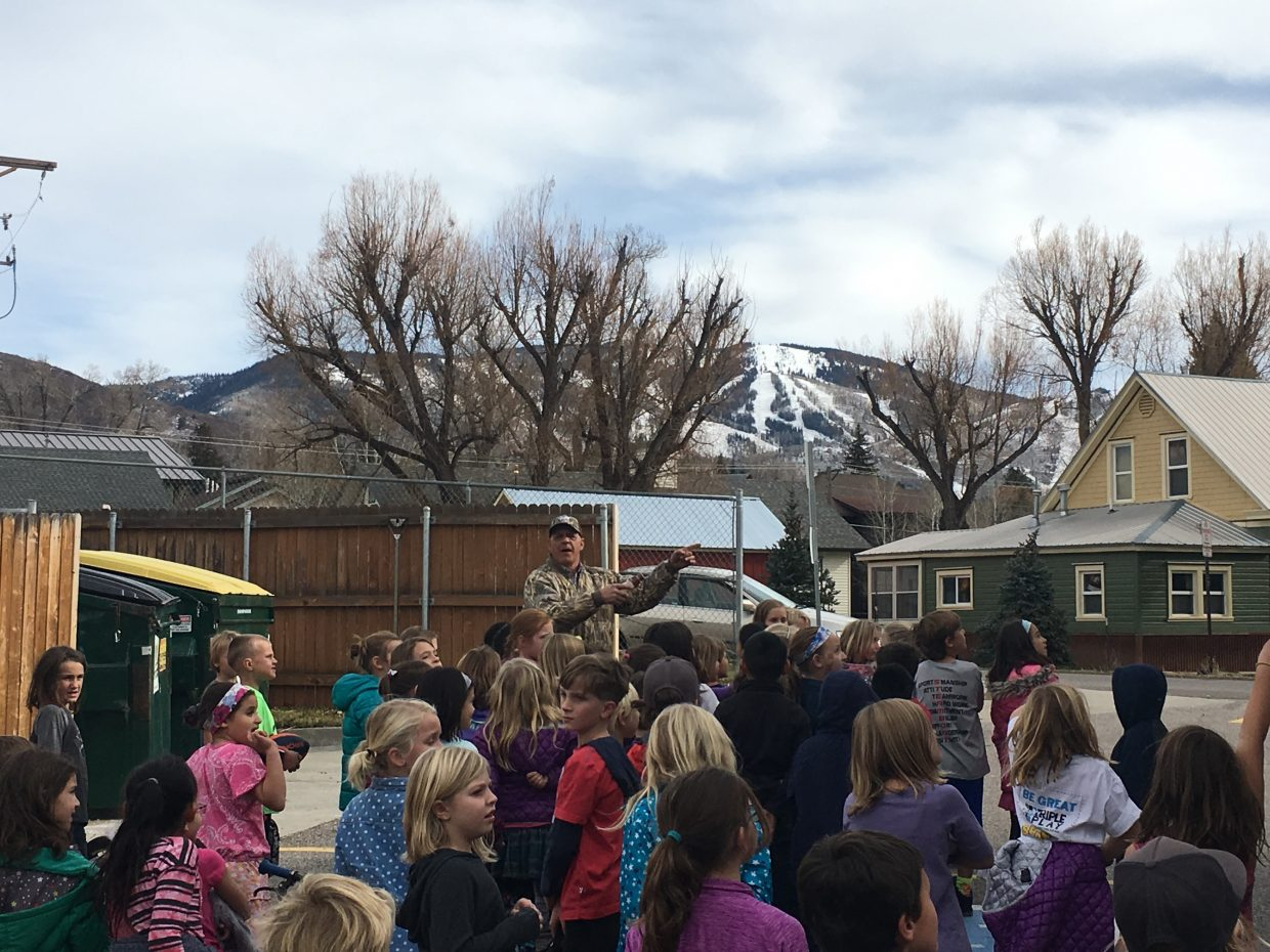 Luke Tellier from Aces High Services, Inc. taught K-5th grade students at Soda Creek Elementary about how a recycling truck works and where it goes once collected.