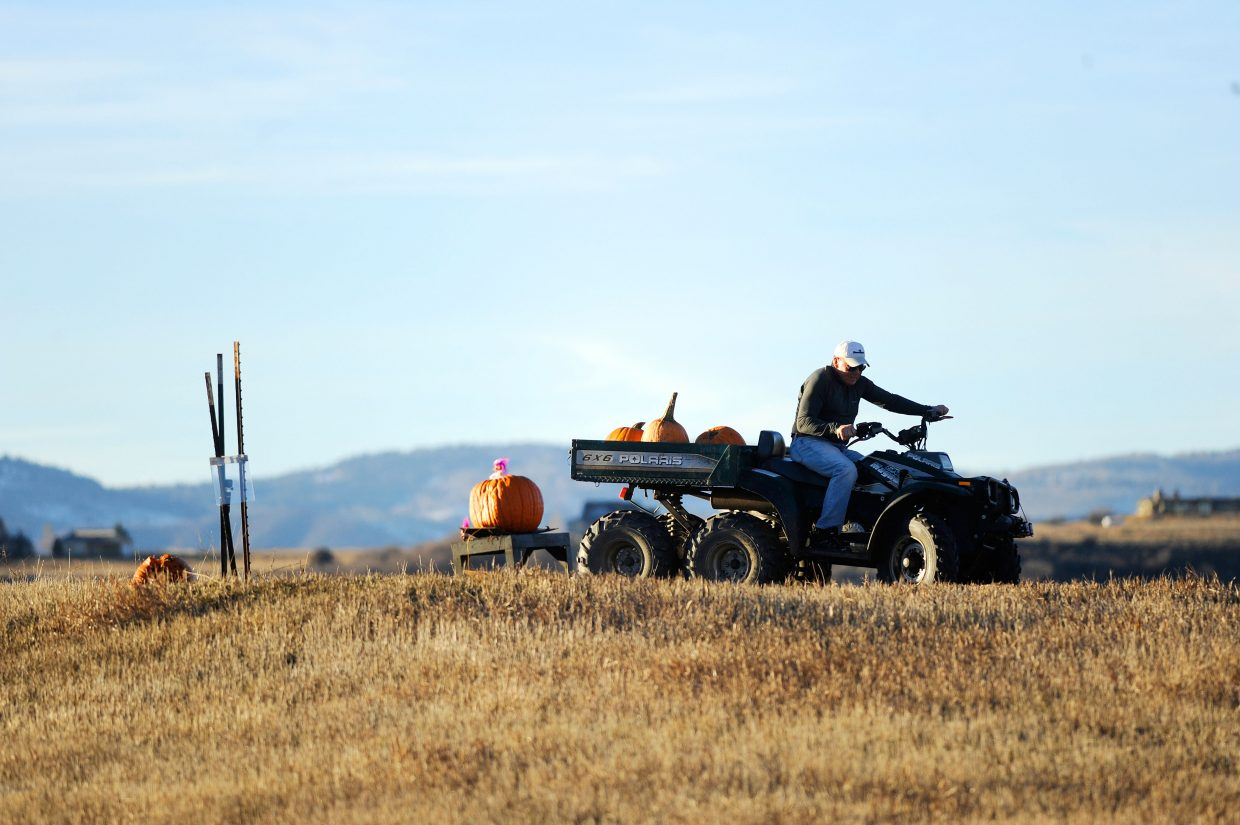 Tim Borden prepares to blow up a pumpkin Monday in his Steamboat Springs hayfield.