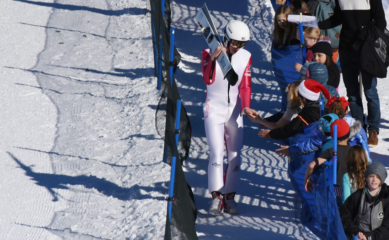 Steamboat Springs skier Ben Berend high fives children at the bottom of the jump at the Continental Cup in Steamboat Springs.