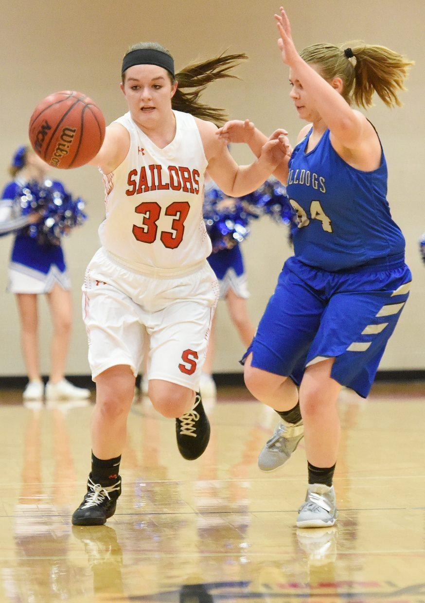 Steamboat's Karly Lanning drives down the court Friday against Moffat County.