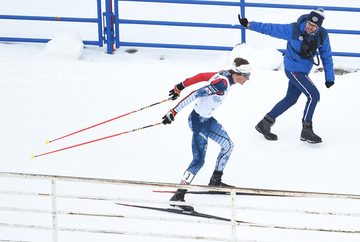 Ben Loomis takes in some advice Saturday during a Nordic combined Continental Cup event in Steamboat Springs.