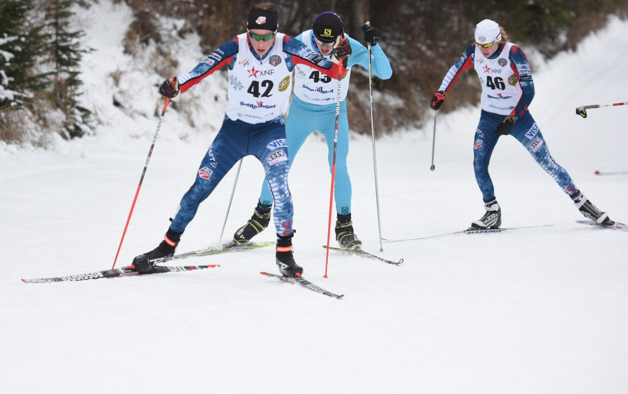 New York skier Beckett Ledger, left, Kazakhstan's Chingiz Rakparov and Minnesota skier Aiden Ripp work their way up a slope Saturday during a Continental Cup Nordic combined race in Steamboat Springs.
