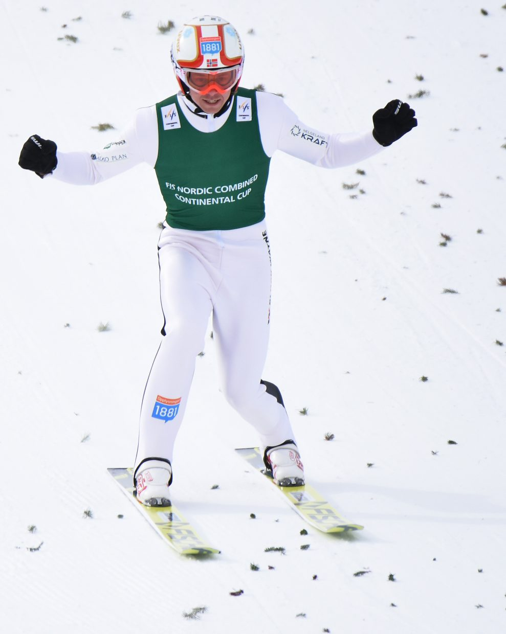 Mikko Kokslien pumps his fists after a strong jump on Saturday during the Continental Cup event in Steamboat Springs.