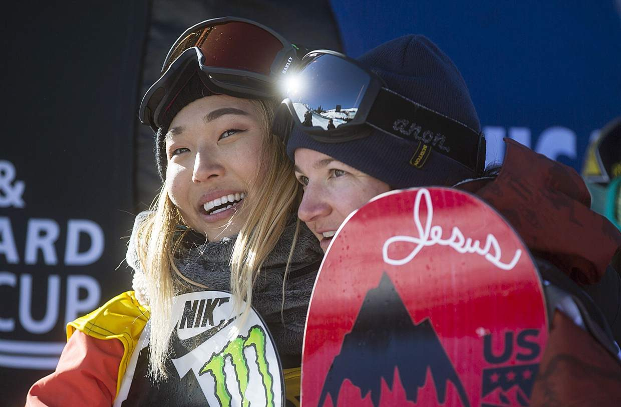 Chloe Kim of United States receives a hug from Kelly Clark of United States following the halfpipe finals during the U.S. Grand Prix event Saturday, Dec. 9, at Copper Mountain.