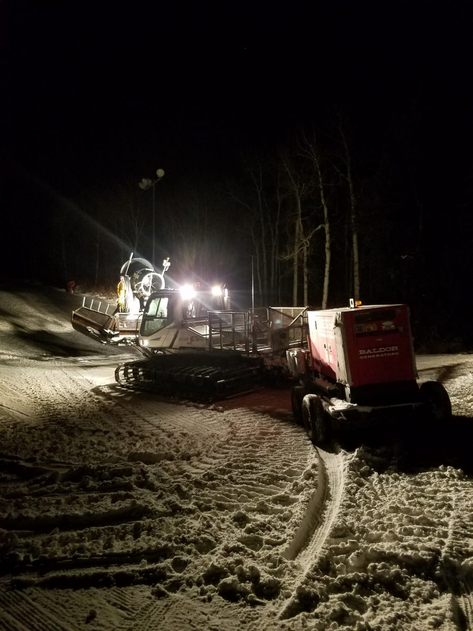 SSRC Snowmakers moving a fan gun and generator.