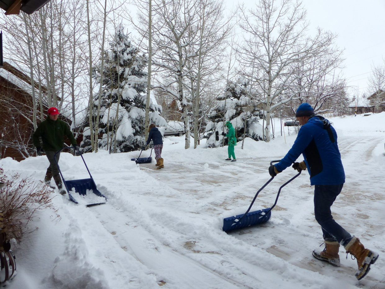 So much snow! Everyone was out snowshoveling… some were in their Christmas jammies.