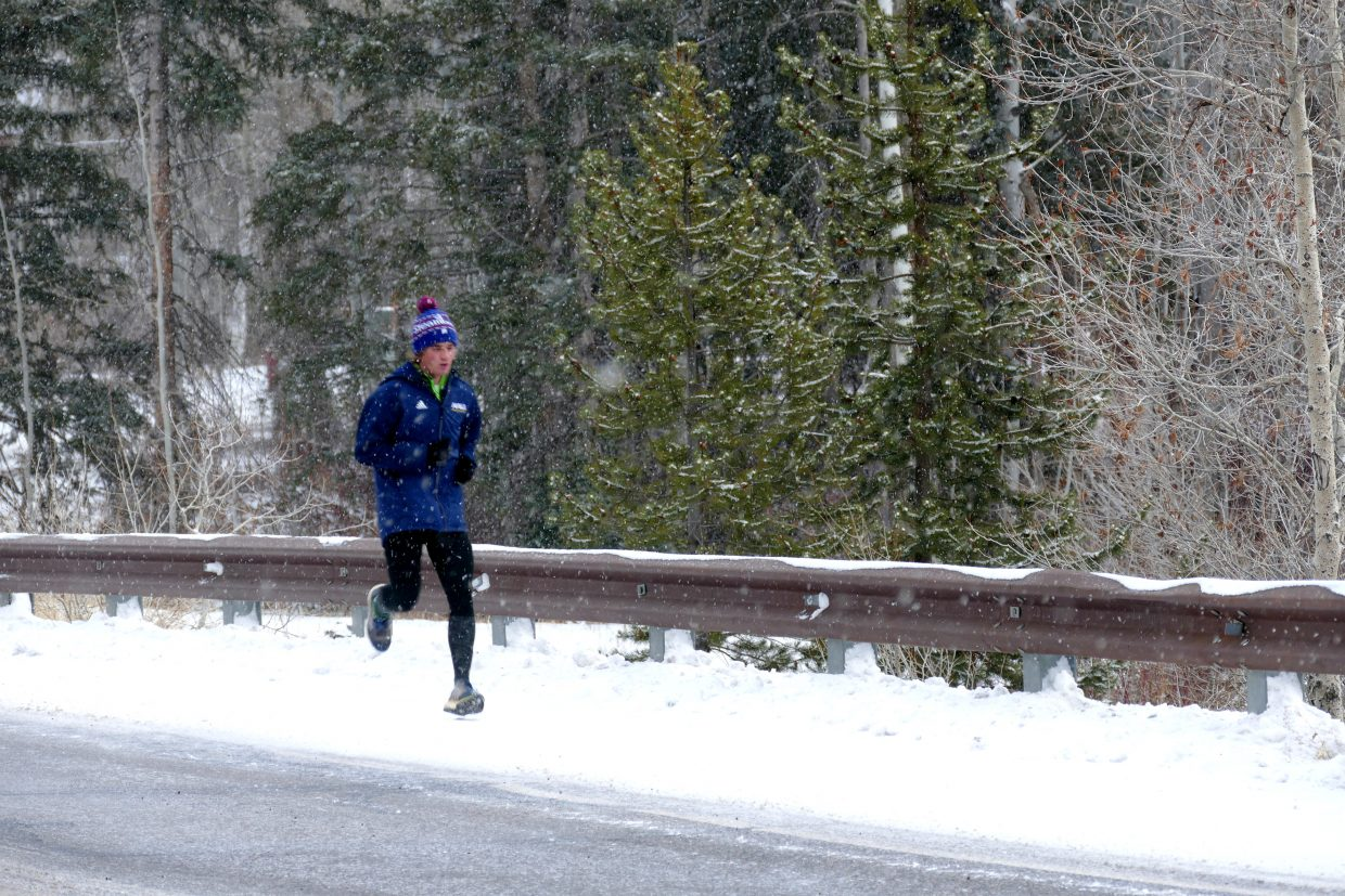 A runner on snowy Steamboat Boulevard.
