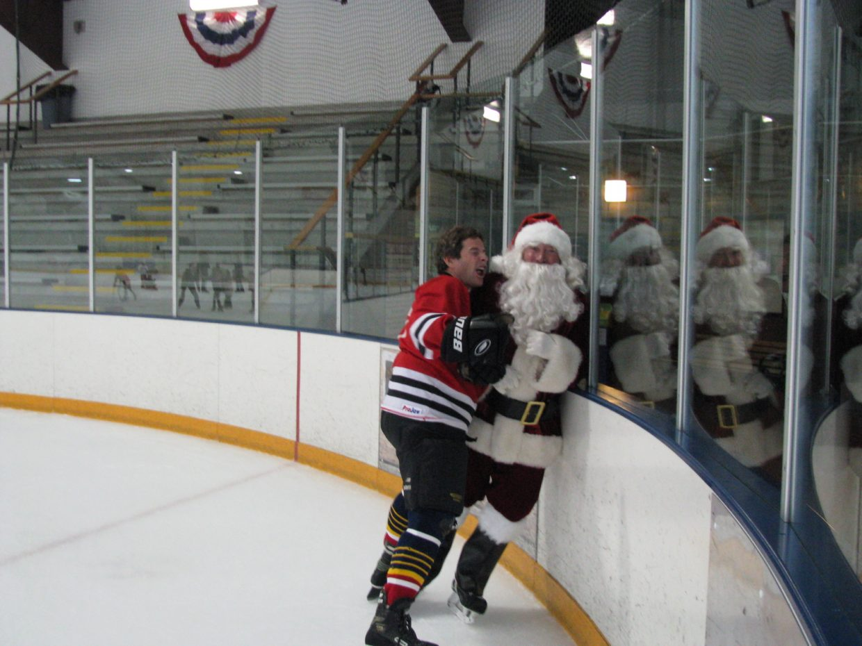 Eugene Buchanan and Santa at the Howelsen Ice Arena.