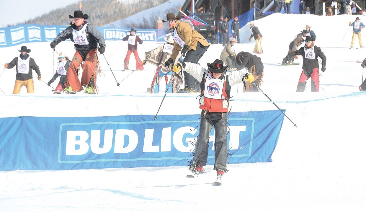 Nate McFadden, a bareback rider from Nebraska, looks to stay ahead of the pack during the stampede at the 44th annual Bud Light Cowboy Downhill, which took place Monday at Steamboat Ski Area.