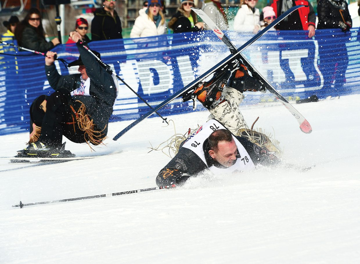Boomer Reeves, a rodeo clown from Texas, takes a nasty fall during the 44th annual Cowboy Downhill at Steamboat Ski Area. This photo was one of the entries in the Steamboat Pilot & Today's first-place award for best photo/story combination.