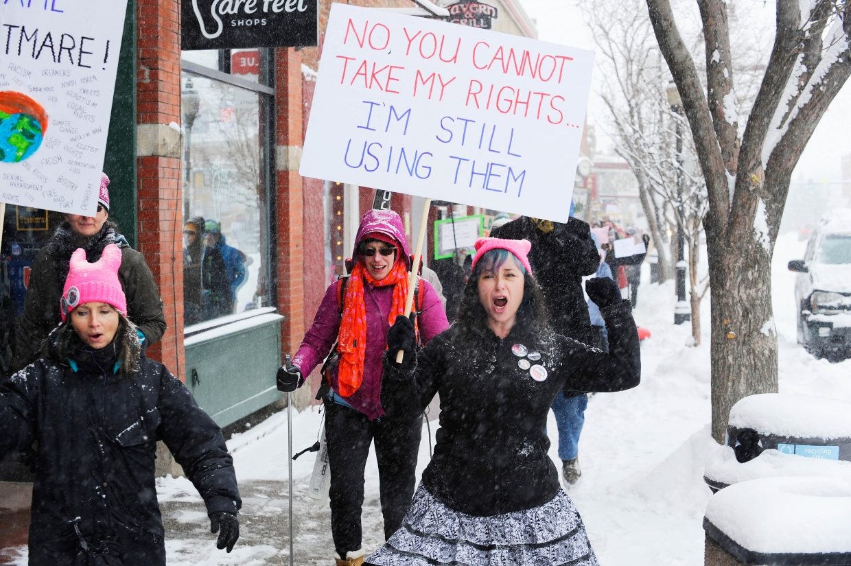 Yvonne Truelove marches down Lincoln Avenue on Sunday during the Women's March in Steamboat Springs.