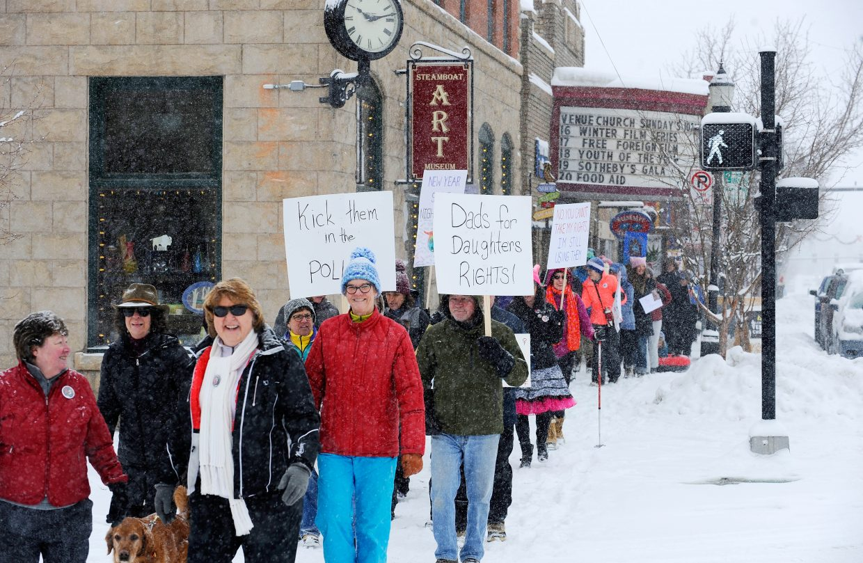 Participants march down Lincoln Avenue on Sunday during the Women's March in Steamboat Springs.
