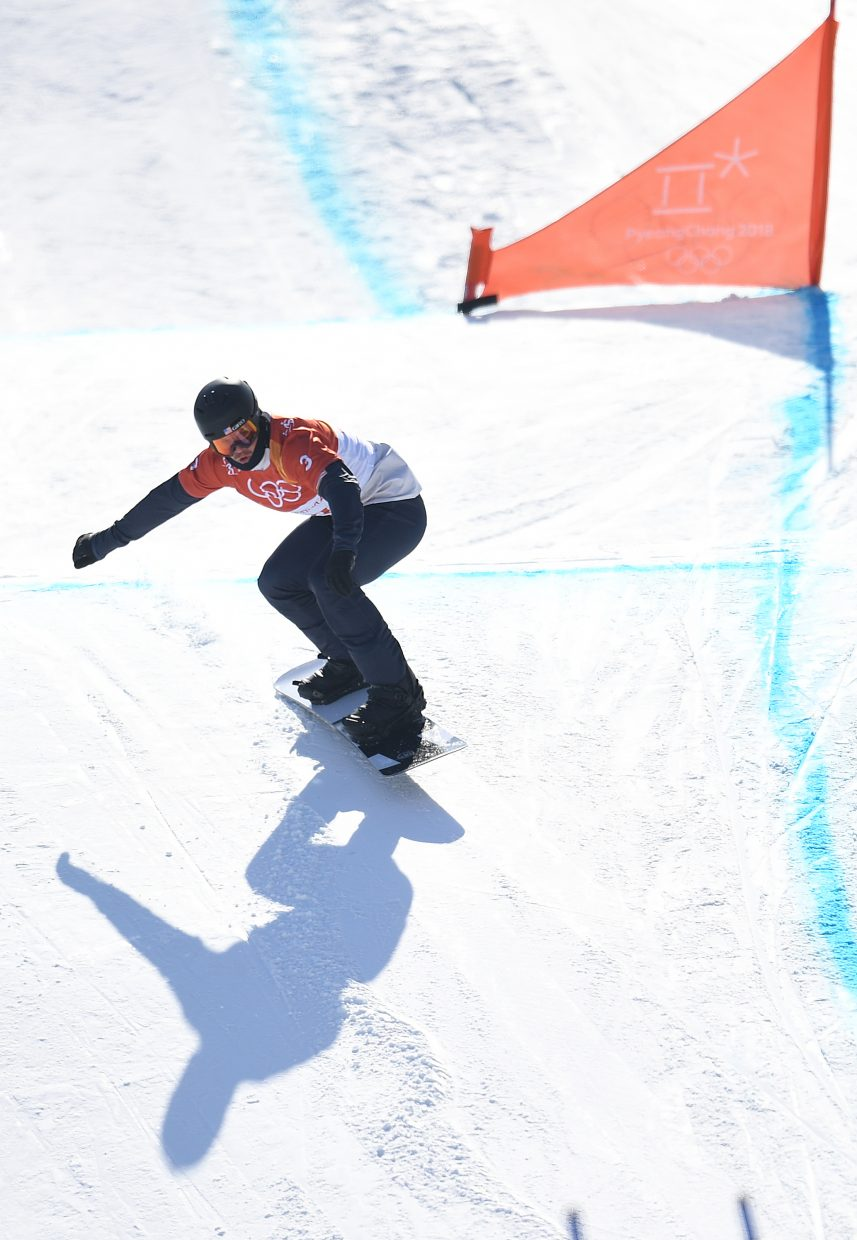 Mick Dierdorff rides in the qualification round of the 2018 Winter Olympics mens snowboard cross event Thursday at Phoenix Snow Park in Pyeongchang, South Korea.