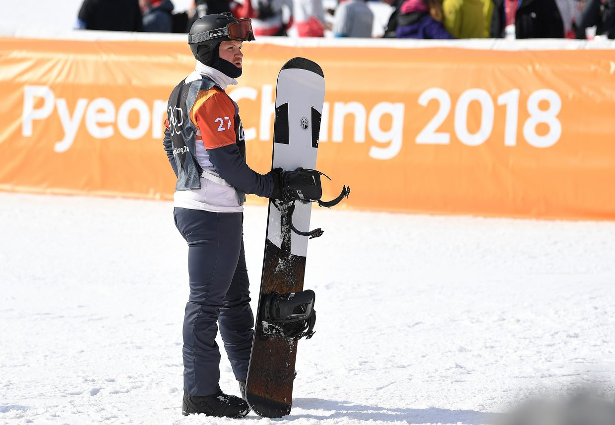 Mick Dierdorff waits to see whether or not he'd advance to the snowboard cross Olympic finals on Thursday at Phoenix Snow Park in Pyeongchang, South Korea.