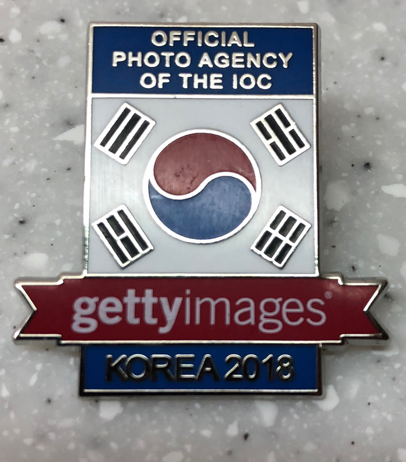 Getty Images pin: Acquired: At the Getty office at MPC. Thoughts: I got this pin during the early part of the Olympics when Stoner and I went on a pin-trading frenzy inside the MPC, visiting every news outlet said to be distributing pins. The guy handing out Getty pins just tossed us each a handful, so I have several. That said, it's specific to Pyeongchang, and to a news outlet, so those are both pluses in my book. Rating: 7
