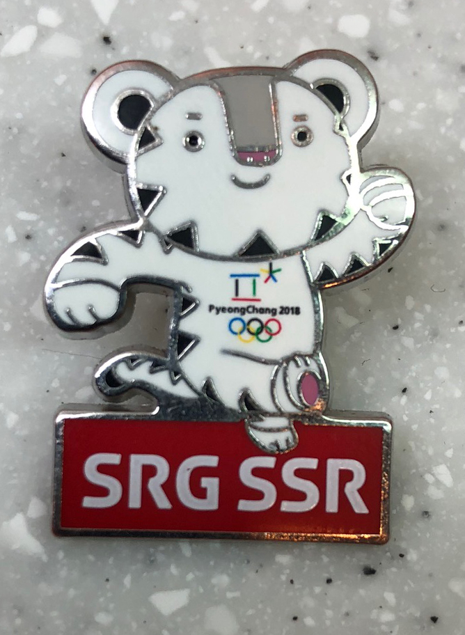 Swiss TV pin: Acquired: From a Swiss broadcaster Thoughts: We were photographing and event and I asked if he had any pins to trade. I had the choice between a little Heidi or this, the Pyeongchang Olympics mascot. Heidi is pretty Swiss, which was tempting, but I went with the mascot as it connected better with the 2018 Olympics. Rating: 6